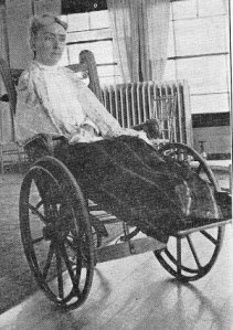 Annie J. Flint i n a wheelchair