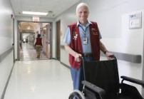 a hospital volunteeer with wheelchair