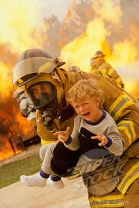 Firefighter carrying a boy