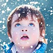 boy looking at snowflakes