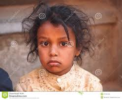sad and hopeless child in poverty