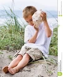 boy listening to seashell